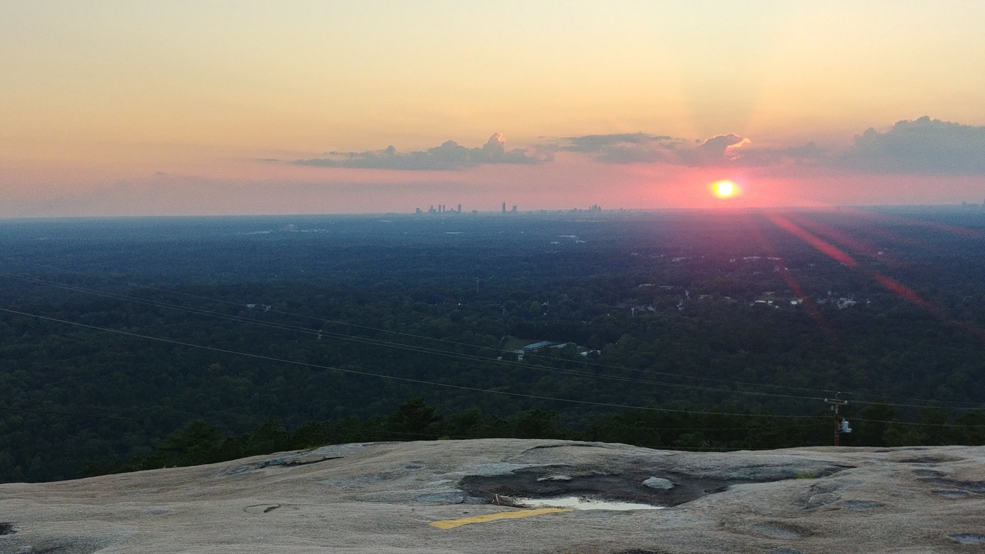 Sunsets on Stone mountain are right into Atlanta downtown